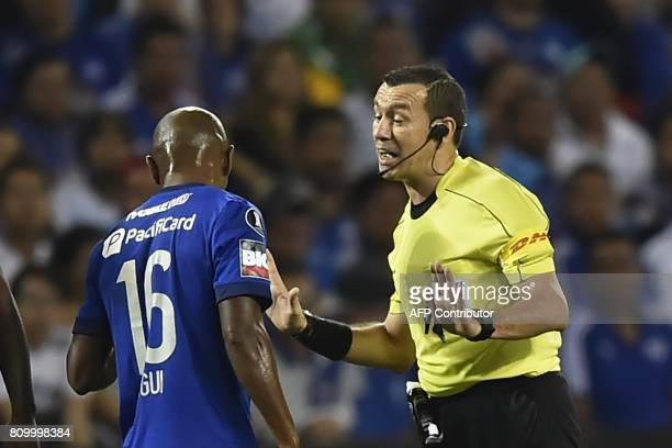 Colombia's referee Wilson Lamouroux speaks with Ecuador's Emelec player Oscar Bagui during their 2017 Copa Libertadores football match at George...