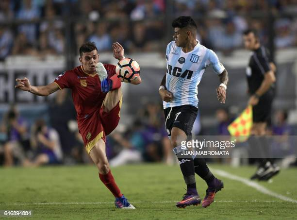 Colombia's Rionegro Aguilas midfielder Daniel Hernandez vies for the ball with Argentina's Racing Club forward Gustavo Bou during their Copa...