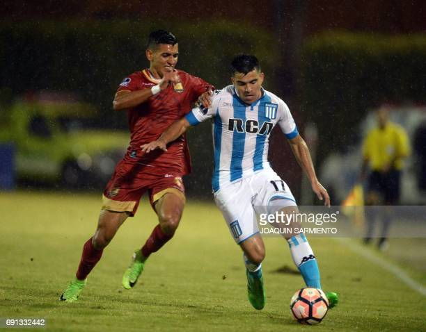 Colombia´s Rionegro Aguilas player Daniel Munoz vies for the ball with Argentina's Racing player Marcos Acuna during their 2017 Copa Sudamericana...