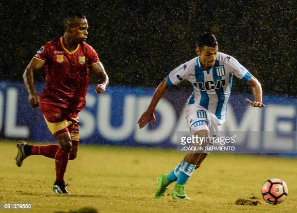 Colombia´s Rionegro Aguilas player Fabian Viafara vies for the ball with Argentina's Racing player Pablo Cuadra during their 2017 Copa Sudamericana...