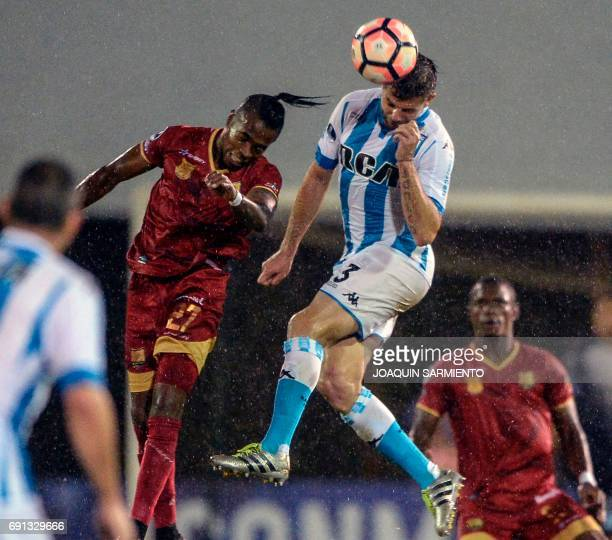 Colombia´s Rionegro Aguilas player Fabian Viafara vies for the ball with Argentina's Racing player Leandro Grimi during their 2017 Copa Sudamericana...