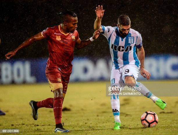 Colombia´s Rionegro Aguilas player Fabian Viafara vies for the ball with Argentina's Racing player Lisandro Lopez during their 2017 Copa Sudamericana...