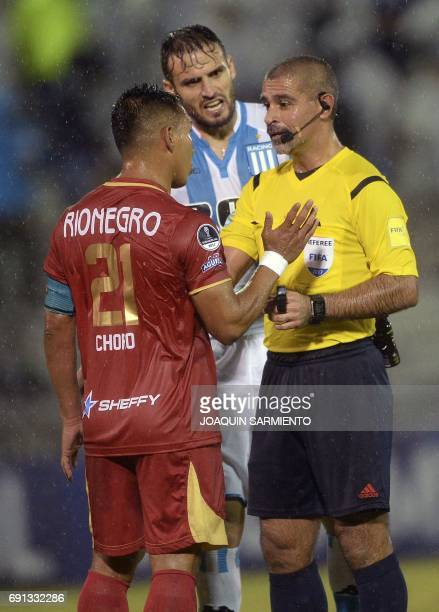 Colombia´s Rionegro Aguilas player John Restrepo talks to Paraguayan referee Eber Aquino during their 2017 Copa Sudamericana football match against...