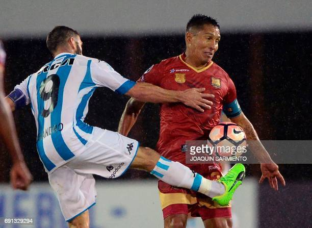 Colombia´s Rionegro Aguilas player John Restrepo vies for the ball with Argentina Racing's Lisandro Lopez during their 2017 Copa Sudamericana...