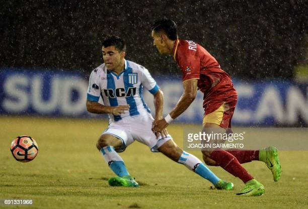 Colombia´s Rionegro player Daniel Munoz vies for the ball with Argentina's Racing player Marcos Acuna during their 2017 Copa Sudamericana football...