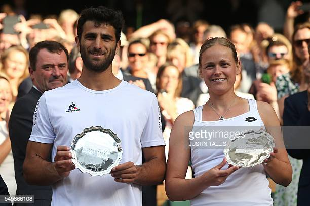 Colombia's Robert Farah and Germany's AnnaLena Groenefeld hold their runners up plates after losing the mixed doubles final on the last day of the...