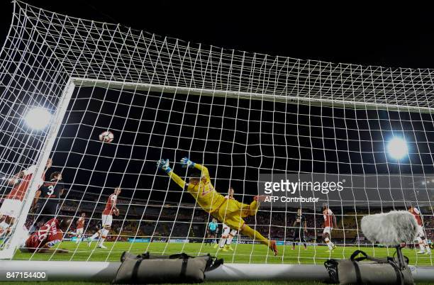 Colombia's Santa Fe goalkeeper Andres Castellanos tries the stop a shot during the Copa Sudamericana football match against Paraguay's Libertad at El...