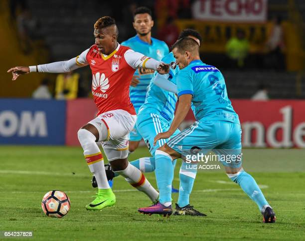 Colombia's Santa Fe Johan Leandro Arango vies for the ball with Peru's Sporting Cristal Gabriel Costa during the Copa Libertadores 2017 Cup football...