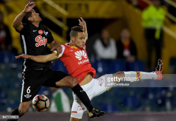 Colombia's Santa Fe player Anderson Plata vies for the ball with Paraguay's Libertad Salustiano Candia during their 2017 Sudamericana Cup football...