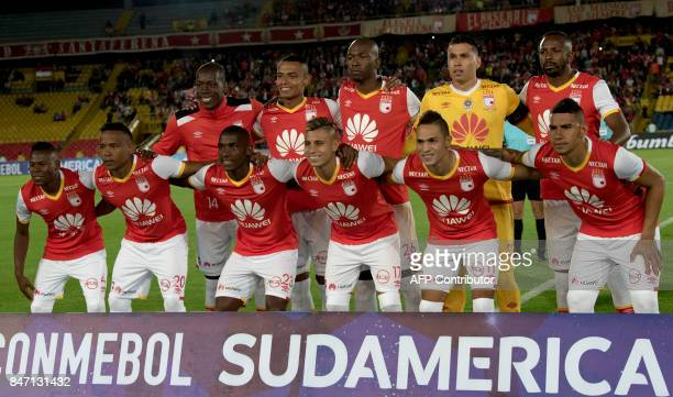 Colombia's Santa Fe players pose for pictures before the start of their Copa Sudamericana football match against Paraguay's Libertad at El Campin...