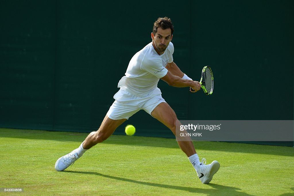 Colombia's Santiago Giraldo returns against Luxembourg's Gilles Muller during their men's singles first round match on the first day of the 2016 Wimbledon Championships at The All England Lawn Tennis Club in Wimbledon, southwest London, on June 27, 2016. / AFP / GLYN