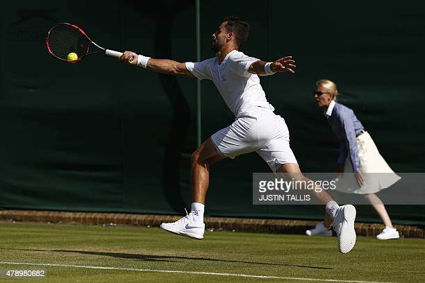 Colombia's Santiago Giraldo stretches for a return against Brazil's Joao Souza during their men's singles first round match on day one of the 2015...