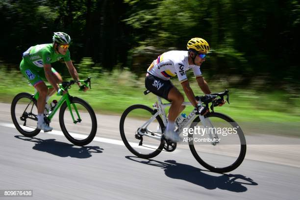 Colombia's Sergio Henao and France's Arnaud Demare wearing the best sprinter's green jersey ride during the 216 km sixth stage of the 104th edition...