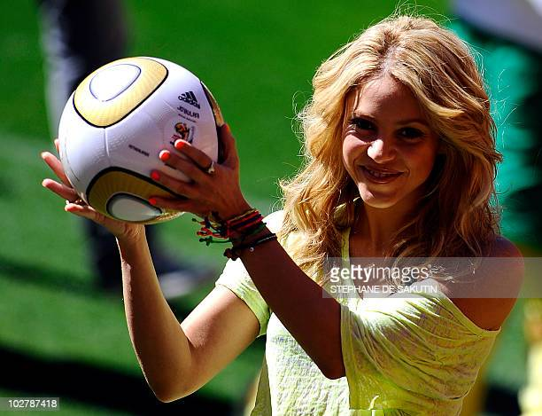 Colombia's singer Shakira holding the Jo'bulani football that will be used for the final of the tournament poses after a press conference on July 10...