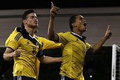 Colombia's striker Carlos Bacca celebrates scoring their first goal with Colombia's midfielder James Rodriguez during the friendly international...