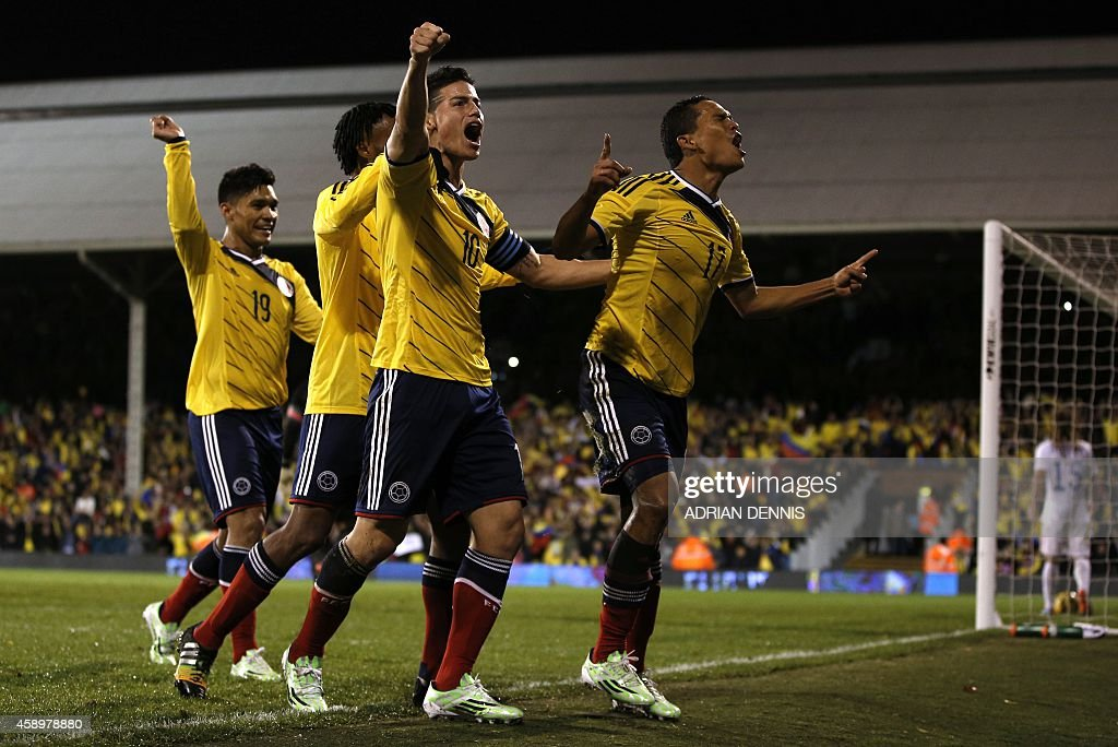 Colombia's striker Carlos Bacca celebrates scoring their first goal with Colombia's midfielder James Rodriguez and teammates during the friendly...