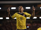 Colombia's striker Carlos Bacca celebrates scoring their first goal during the friendly international football match between United States and...