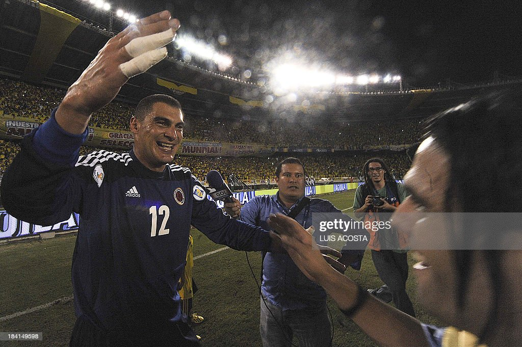 Colombia's susbtitute goalkeeper Faryd Mondragon celebrates after qualifying for the Brazil 2014 FIFA World Cup after a 3-3 tie with Chile in a South American qualifier match, in Barranquilla, Colombia, on October 11, 2013.