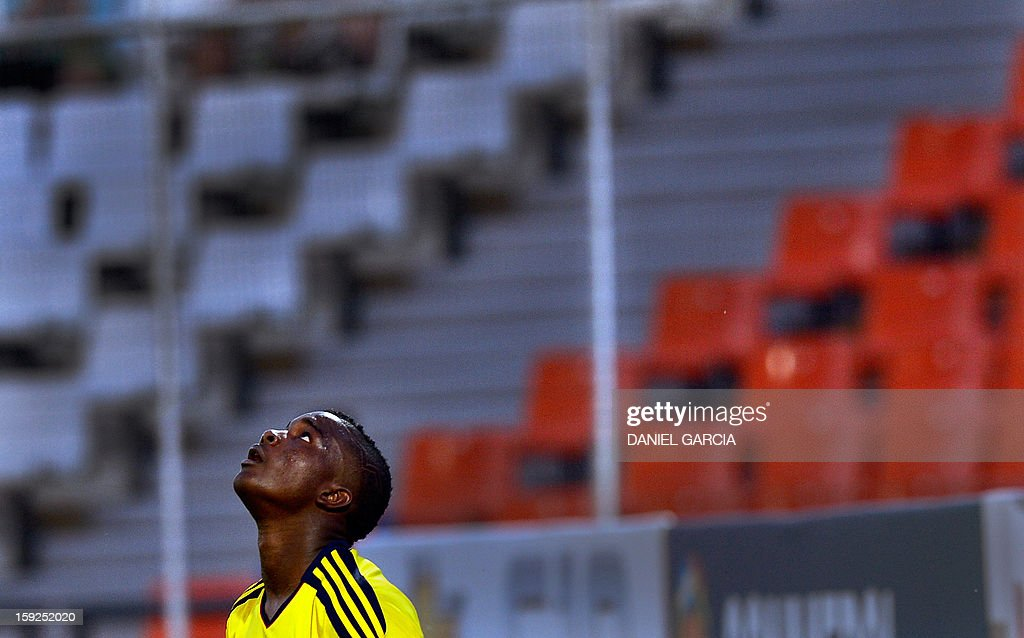 Colombia's U-20 forward Jhon Cordoba reacts after missing a goal opportunity against Paraguay during the South American U-20 Championship Group A football match at Malvinas Argentinas stadium in Mendoza, Argentina, on January 9, 2013. Four teams will qualify for the Turkey 2013 FIFA U-20 World Cup.