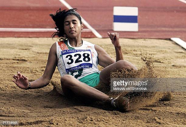 Indian athlete Anju Bobby George competes on her way to winning the gold medal in the women's long jump final at the 10th South Asian Federation...
