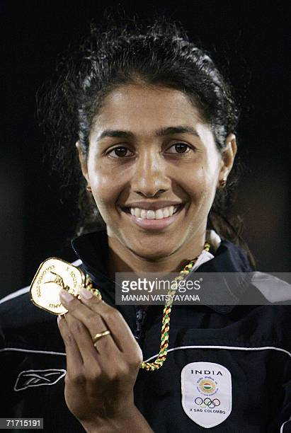 Indian athlete Anju Bobby George poses with her gold medal after winning the women's long jump final at the 10th South Asian Games in Colombo 25...