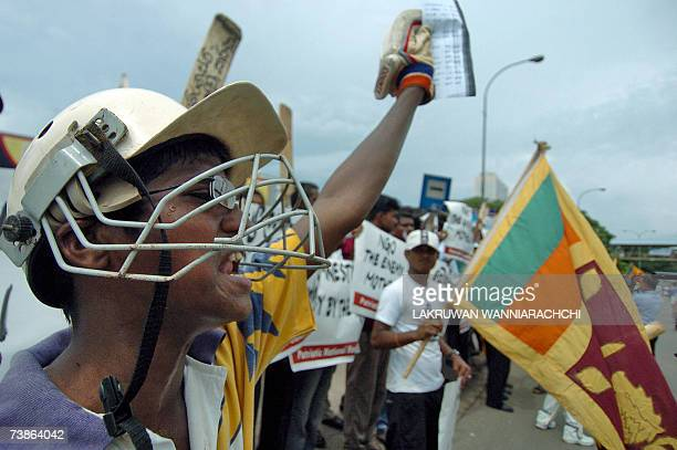 Sri Lankan activists some dressed in national cricket jerseys and sporting cricket bats shout slogans and wave banners during a demonstration in...