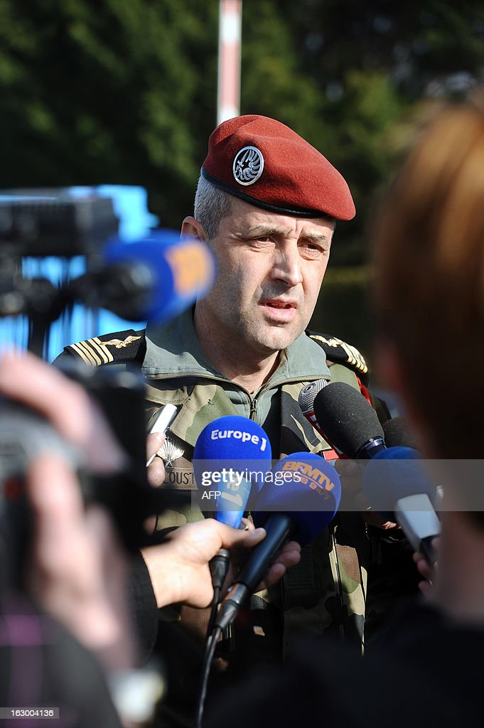 Colonel Antoine De Loustal speaks to journalists on March 3, 2013 in Pamiers, southwestern France, in front of the entrance of the 1st Parachute Chasseur Regiment barracks (RCP), an airbone infantry unit of the French Army, where the French soldier killed in northern Mali on March 2 was based. France said on March 3 that one of its soldiers had been killed in fighting in northern Mali, in the third death of a French serviceman since the launch of its military intervention in mid-January. The defence ministry identified the soldier as Corporal Cedric Charenton, 26, who had been deployed in Mali since January 25 and had previously served in Afghanistan and Gabon. AFP PHOTO /REMY GABALDA