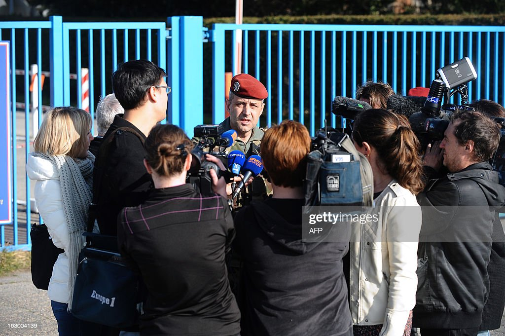Colonel Antoine De Loustal speaks to journalists on March 3, 2013 in Pamiers, southwestern France, in front of the entrance of the 1st Parachute Chasseur Regiment barracks (RCP), an airbone infantry unit of the French Army, where the French soldier killed in northern Mali on March 2 was based. France said on March 3 that one of its soldiers had been killed in fighting in northern Mali, in the third death of a French serviceman since the launch of its military intervention in mid-January. The defence ministry identified the soldier as Corporal Cedric Charenton, 26, who had been deployed in Mali since January 25 and had previously served in Afghanistan and Gabon.