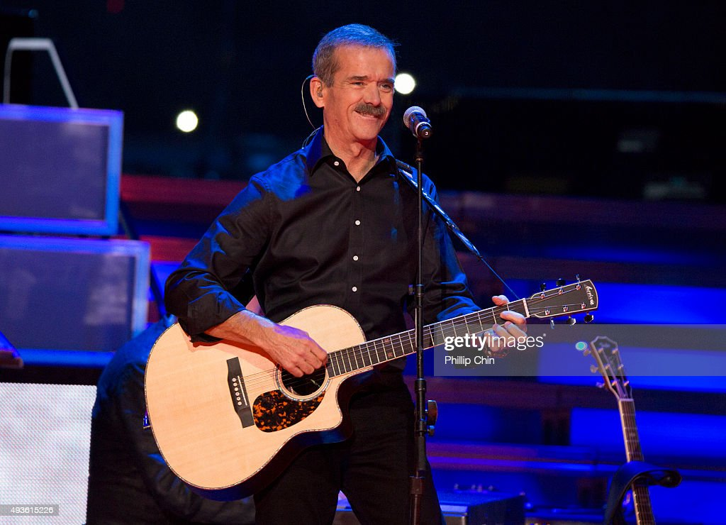 Colonel <a gi-track='captionPersonalityLinkClicked' href=/galleries/search?phrase=Chris+Hadfield&family=editorial&specificpeople=2700911 ng-click='$event.stopPropagation()'>Chris Hadfield</a> performs with Barenaked Ladies at We Day Vancouver at Rogers Arena on October 21, 2015 in Vancouver, Canada.
