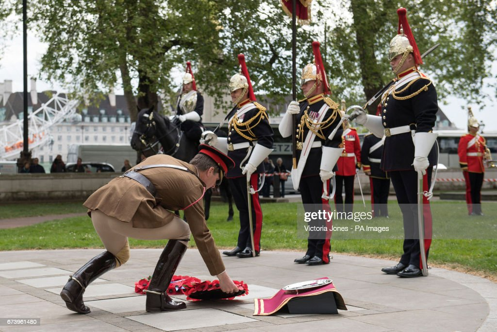 Colonel Crispin Lockhart MBC lays a poppy wreath at the memorial paving stone unveiled in Victoria Embankment Gardens in Westminster, London, during a commemoration event for Second Lieutenant John Spencer Dunville.