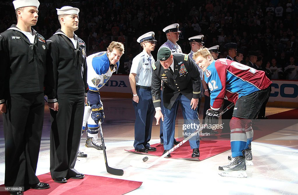 Colonel David L. Grosso drops a ceremonial 1st puck in front of captains <a gi-track='captionPersonalityLinkClicked' href=/galleries/search?phrase=Gabriel+Landeskog&family=editorial&specificpeople=6590816 ng-click='$event.stopPropagation()'>Gabriel Landeskog</a> #92 of the Colorado Avalanche and <a gi-track='captionPersonalityLinkClicked' href=/galleries/search?phrase=David+Backes&family=editorial&specificpeople=2538492 ng-click='$event.stopPropagation()'>David Backes</a> #42 of the St Louis Blues as part of military appreciation night at the Pepsi Center on April 21, 2013 in Denver, Colorado.