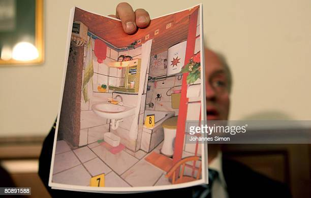 Colonel Franz Polzer chief investigator of the district of Lower Austria shows a detail picture of the cellar appartement where a father imprisoned...