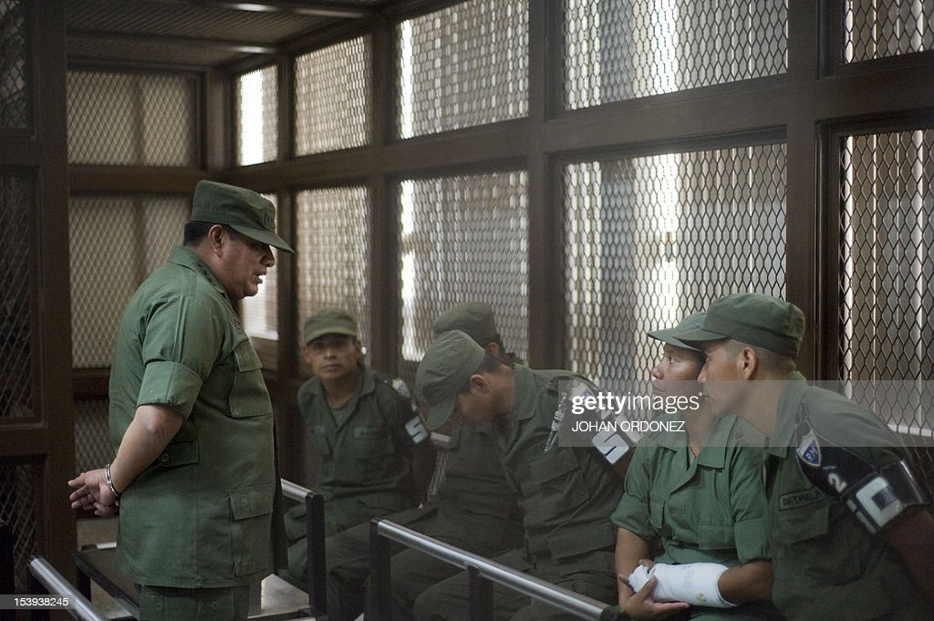 Colonel Juan Chiroy Sal speaks with five of eight soldiers all of them accused of extrajudicial execution of eight natives during clashes between...