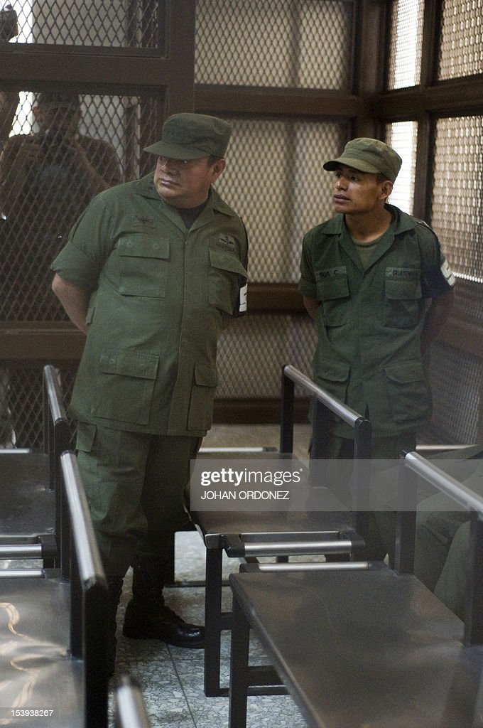 Colonel Juan Chiroy Sal speaks with one of eight soldiers all of them accused of extrajudicial execution of eight natives during clashes between...