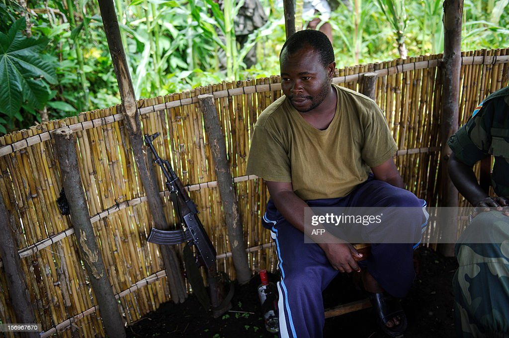 Colonel Mirimo Korini, an APCLS Mai-Mai commander, sits in a small hut near the village of Shasha, 11 km south of Sake, in the east of the Democratic Republic of the Congo on November 26, 2012. The government-allied Mai Mai group form a front line against M23 rebels who advanced through swathes of North Kivu province last week. AFP PHOTO/PHIL MOORE