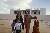 Colonel Muammar Gaddafi with his wife Safia and daughter Aicha near Bab Azizia palace destroyed in a US air raid and left in ruins November 1986