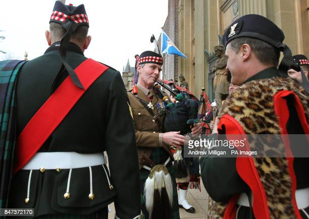 Colonel of the The Royal Regiment of Scotland Lieutenant General Andrew Graham plays the bagpipes after the Royal Regiment of Scotland paraded from...