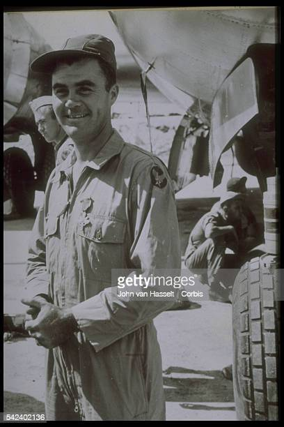 Colonel Paul Tibbets who commanded the plane which dropped the atomic bomb on Hiroshima standing by the Enola Gay after the mission wearing the...