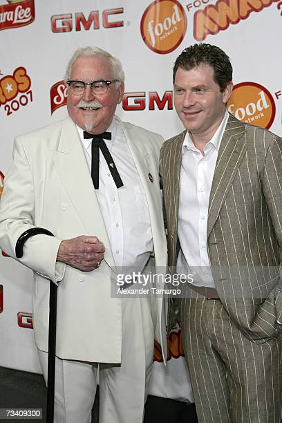Colonel Sanders of KFC and Bobby Flay pose on the red carpet before the Food Network Awards show on February 23 2007 in Miami Beach Florida