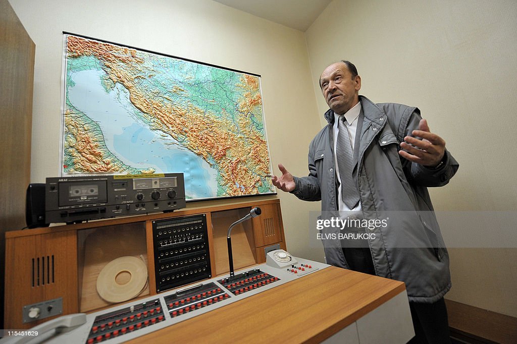 SMAJILHODZIC- Colonel Serif Grabovica, who was in charged along with other soldiers to guard the nuclear shelter in 1979, gestures in a communication room of the bunker, in Konjic, on May 11, 2011. The shelter was built from 1956 until the late 1970s to provide a sheltered command post for ex-Yugoslavia's iconic communist leader Josip Broz Tito and the country's top leadership in case of a nuclear cataclysm. The Biennale of Contemporary Art runs from May 27, 2011 to October 2011 in Tito's atomic shelter.