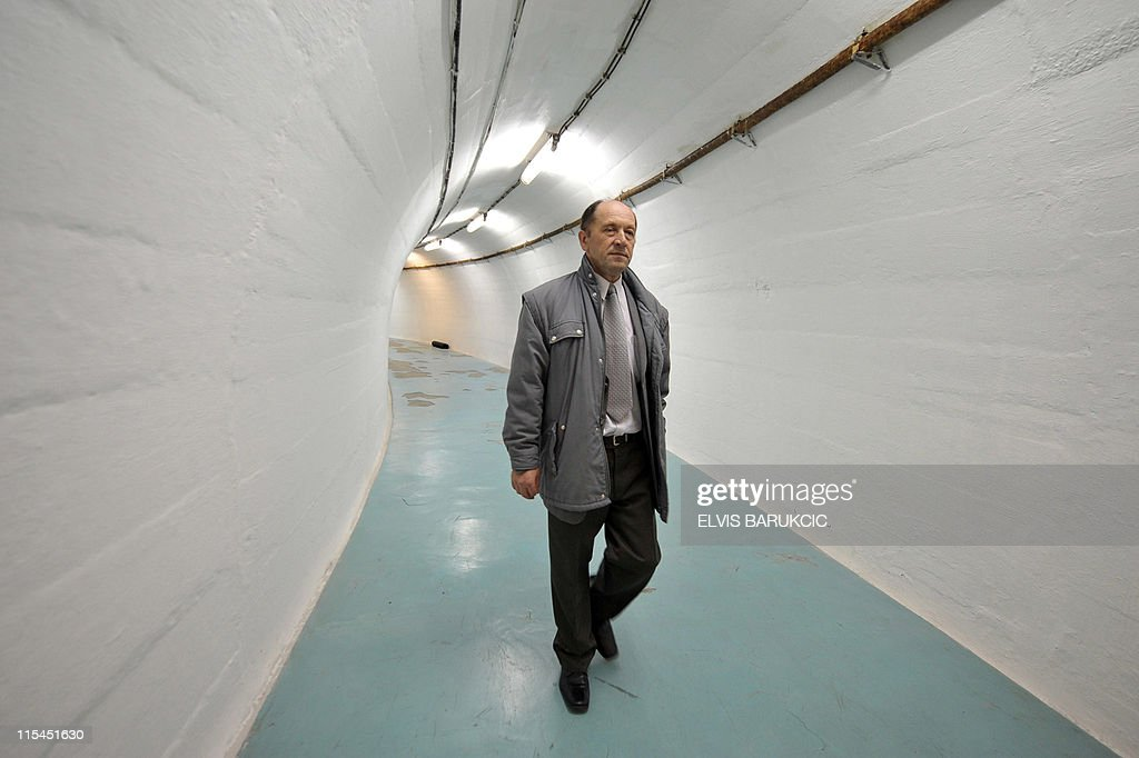 SMAJILHODZIC- Colonel Serif Grabovica, who was in charged along with other soldiers to guard the nuclear shelter in 1979, walks in one of the tunnels of the bunker, in Konjic, on May 11, 2011. The shelter was built from 1956 until the late 1970s to provide a sheltered command post for ex-Yugoslavia's iconic communist leader Josip Broz Tito and the country's top leadership in case of a nuclear cataclysm. The Biennale of Contemporary Art runs from May 27, 2011 to October 2011 in Tito's atomic shelter.