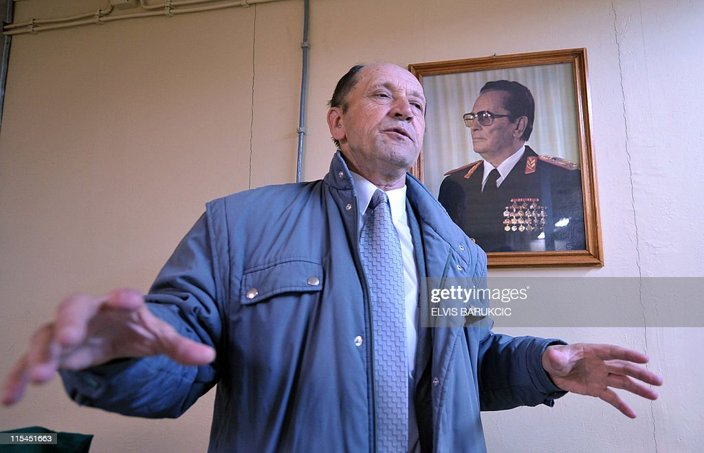 SMAJILHODZIC- Colonel Serif Grabovica, who was in charged along with other soldiers to guard ex-Yugoslavia's iconic communist leader Josip Broz Ti's nuclear shelter in 1979, gestures in room of the bunker in front of a picture of the former leader, in Konjic, on May 11, 2011. The shelter was built from 1956 until the late 1970s to provide a sheltered command post for Tito and the country's top leadership in case of a nuclear cataclysm. The Biennale of Contemporary Art runs from May 27, 2011 to October 2011 in Tito's atomic shelter.