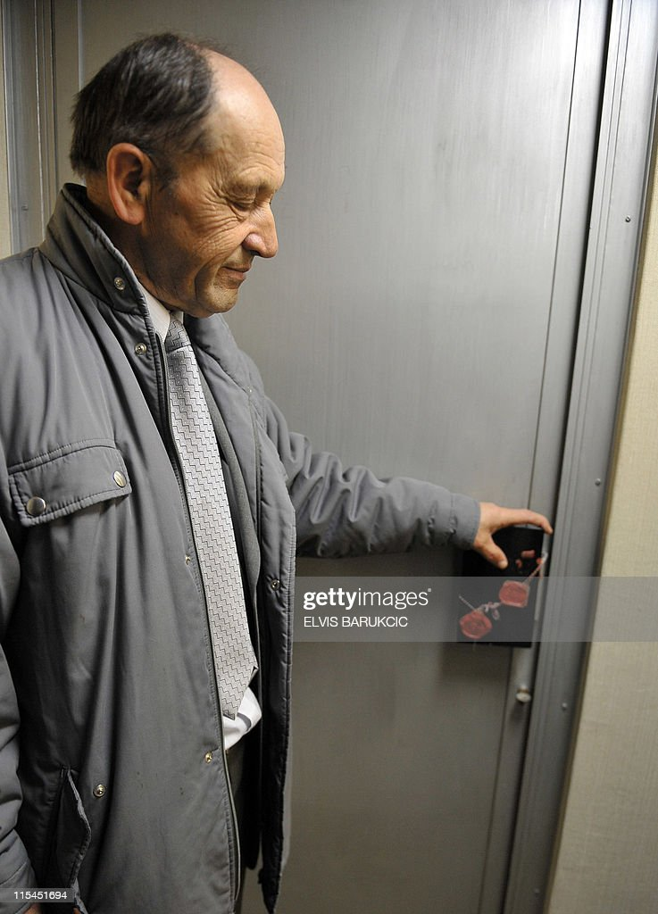 SMAJILHODZIC- Colonel Serif Grabovica, who was in charged along with other soldiers to guard ex-Yugoslavia's iconic communist leader Josip Broz Ti's nuclear shelter in 1979, stands in front of a sealed door where war plans were kept in the bunker, in Konjic, on May 11, 2011. The shelter was built from 1956 until the late 1970s to provide a sheltered command post for Tito and the country's top leadership in case of a nuclear cataclysm. The Biennale of Contemporary Art runs from May 27, 2011 to October 2011 in Tito's atomic shelter.