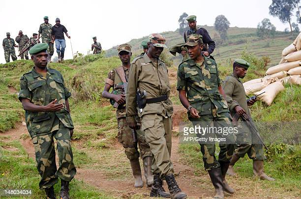 Colonel Sultani Makenga head of the rebel M23 group walks on a hill in Bunagana a town near the Ugandan border on July 8 2012 Colonel Sultani Makenga...