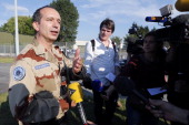 Colonel Touron deputy commander of the French Criminal Analysis Unit speaks to the press while investigators from the French Air Transport...