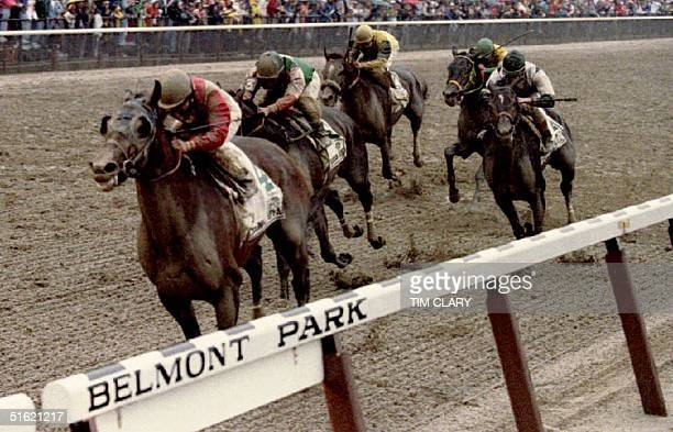 Colonial Affair ridden by jockey Julie Krone crosses the finish line to win the Belmont Stakes 05 June Krone is the first woman jockey to ever win a...