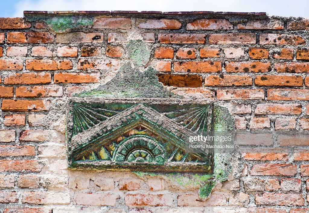 Colonial architectural detail in weathered brick wall Conserving Cuban heritage during reconstruction