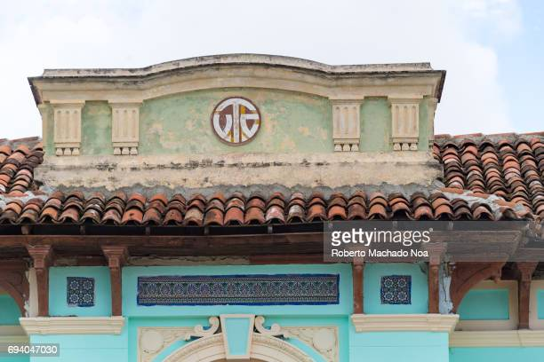 Colonial architecture of the current 'CV Deportivo 'Top part of an artistic old style dilapidated building with tiled roof