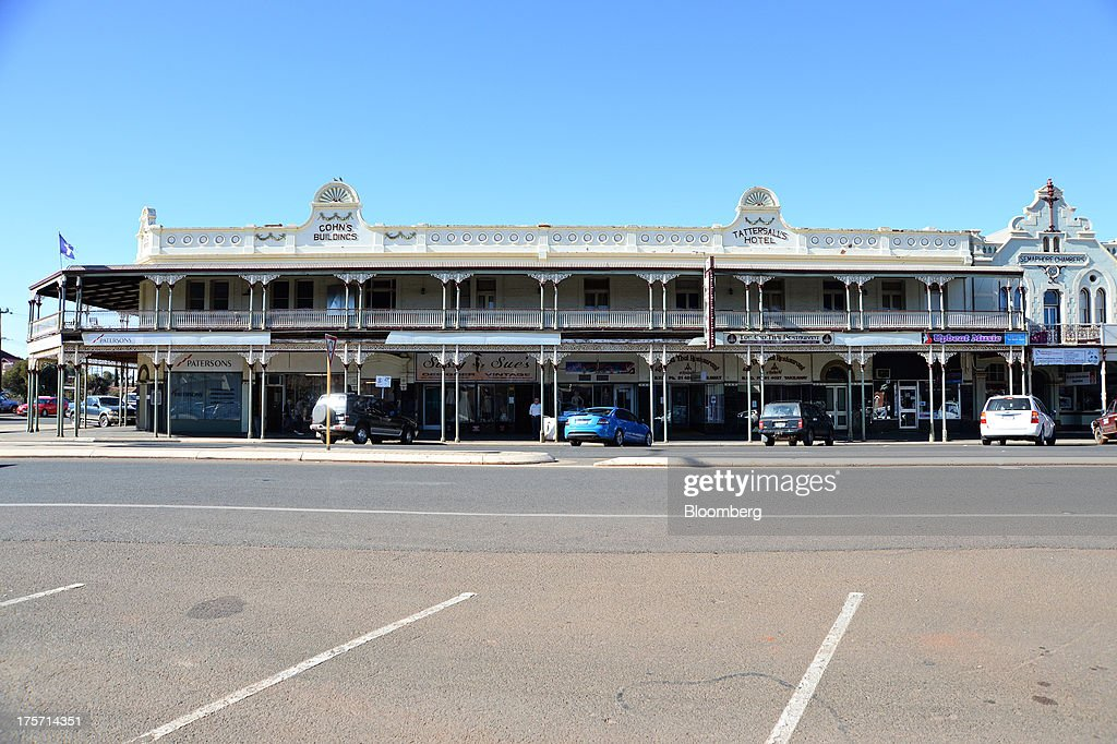 A colonial building occupied by stores stands on Hannan Street in Kalgoorlie, Australia, on Wednesday, Aug. 7, 2013. Kalgoorlie, a town in the Goldfields-Esperance region of Western Australia, is home to the annual Diggers & Dealers mining forum. Photographer: Carla Gottgens/Bloomberg via Getty Images