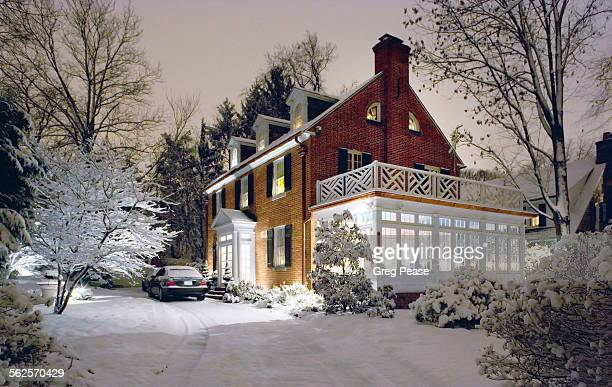 Colonial house on a snowy night